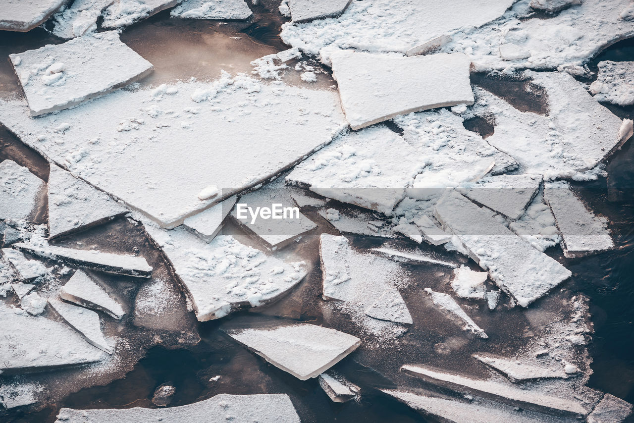 High Angle View Of Frozen Lakeshore