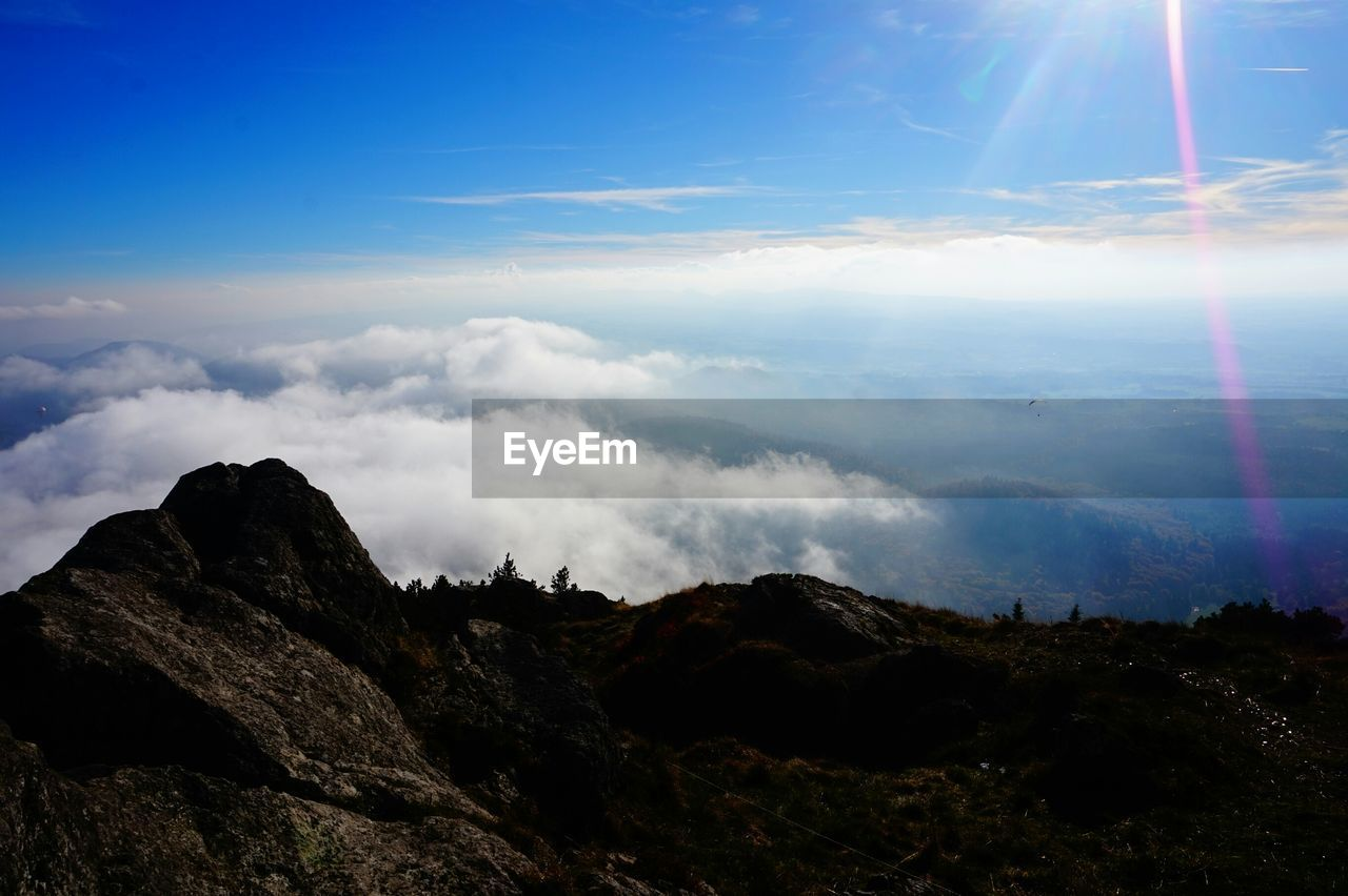 Scenic view of mountains against cloudscape