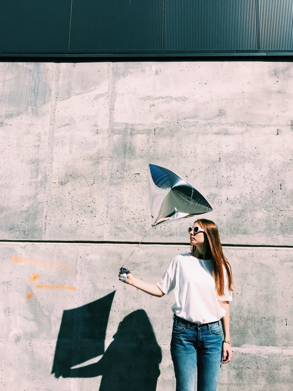 Woman Standing Against Wall In City