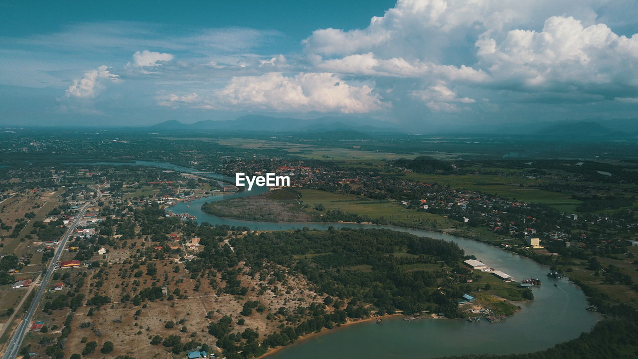 water, cloud - sky, sky, building exterior, architecture, built structure, city, aerial view, nature, scenics - nature, day, cityscape, environment, river, landscape, high angle view, no people, beauty in nature, outdoors
