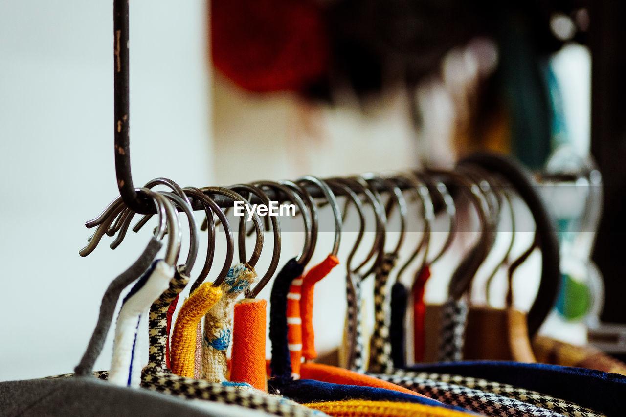 Close-up of coat hangers on rack