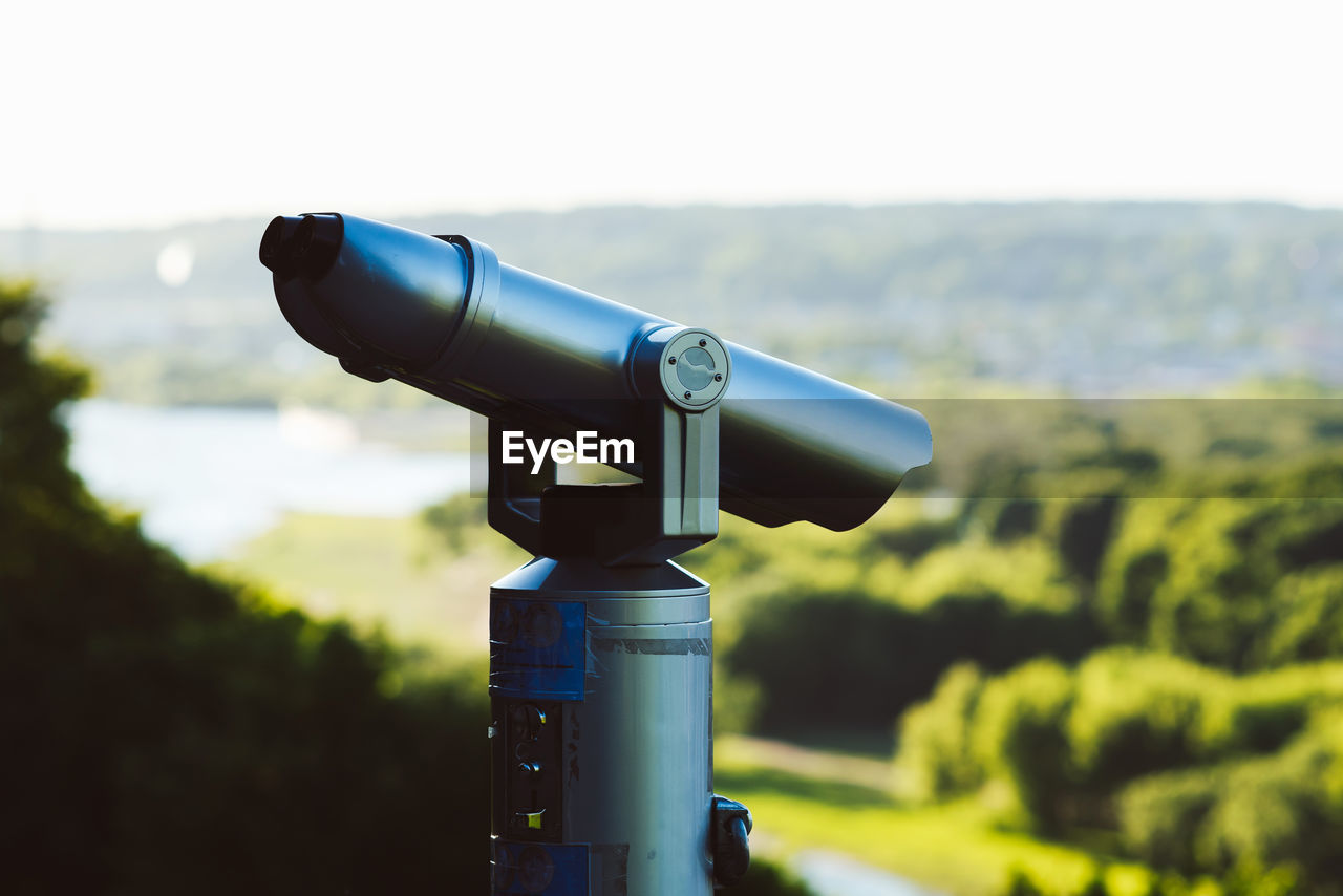 coin operated, binoculars, focus on foreground, surveillance, optical instrument, security, sky, coin-operated binoculars, day, nature, technology, astronomy, no people, outdoors, telescope, close-up, environment, landscape, hand-held telescope, metal, silver colored