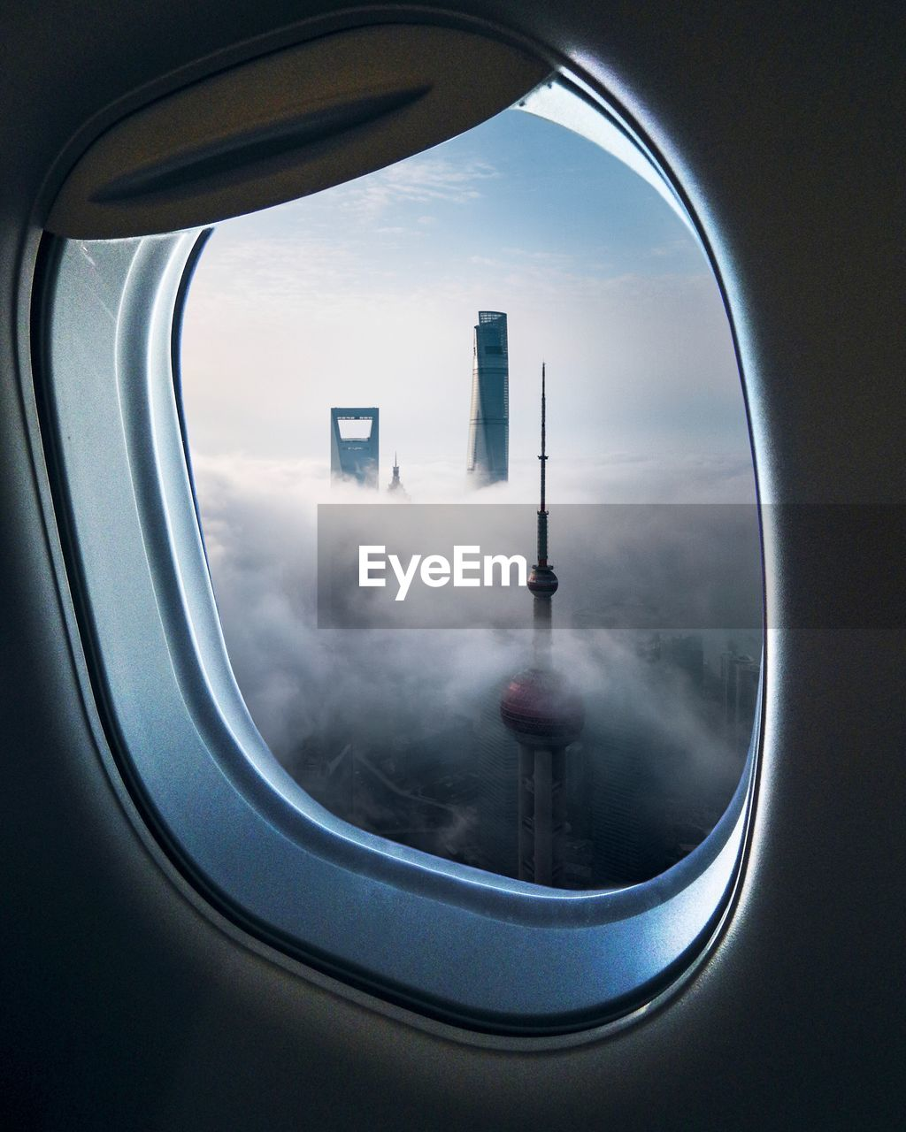 Modern skyscrapers seen through airplane window
