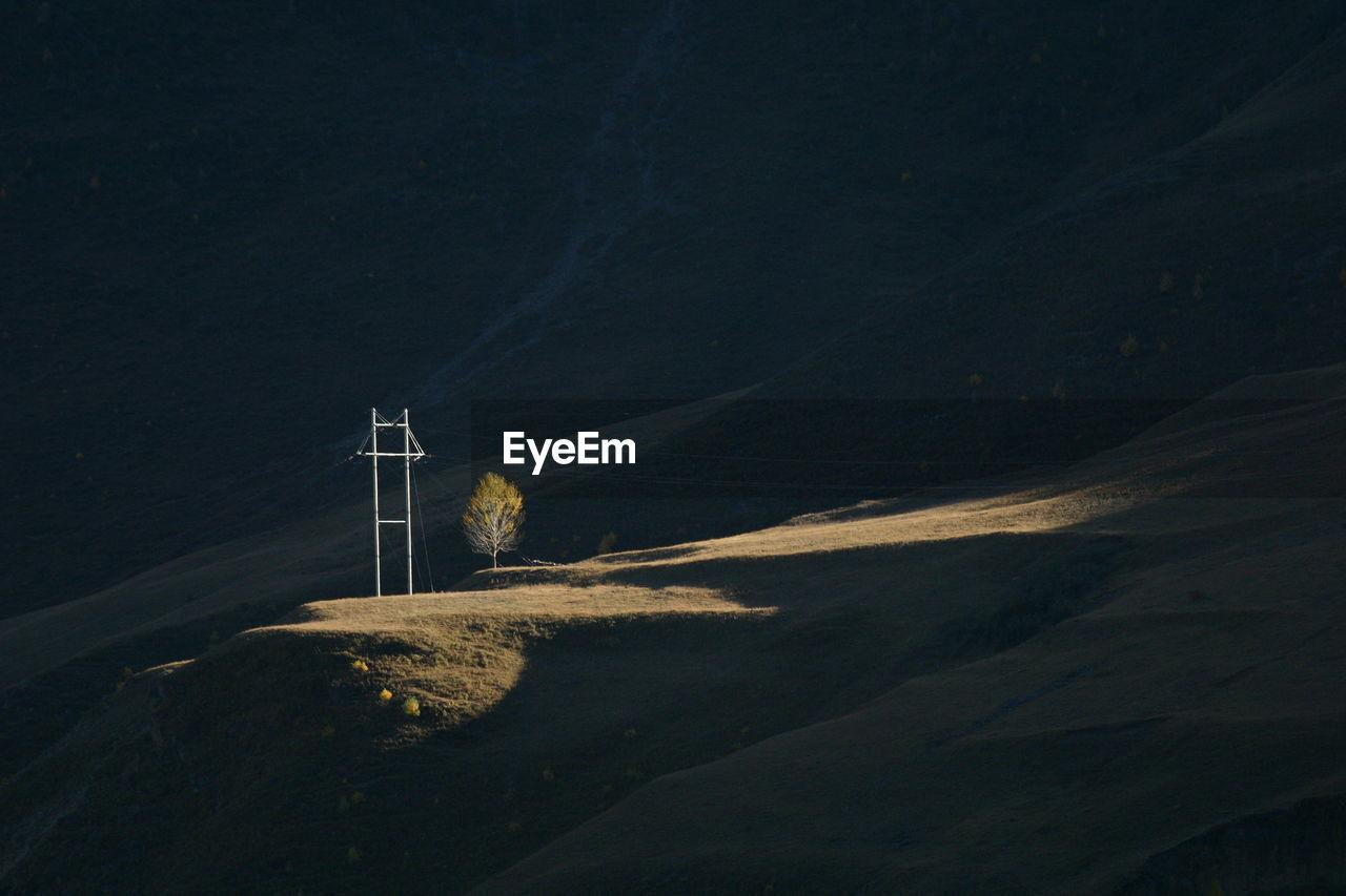 Electricity Pylon On Field