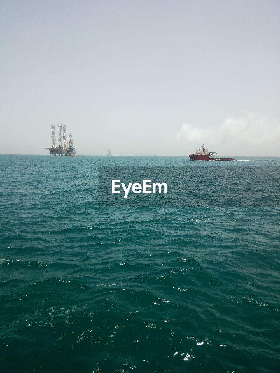 SHIP SAILING ON SEA AGAINST CLEAR SKY