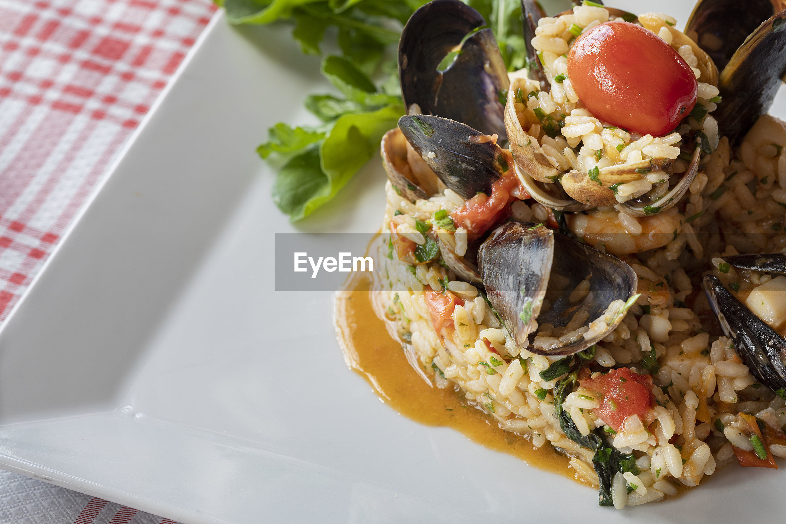 A plate of italian risotto with seafood.