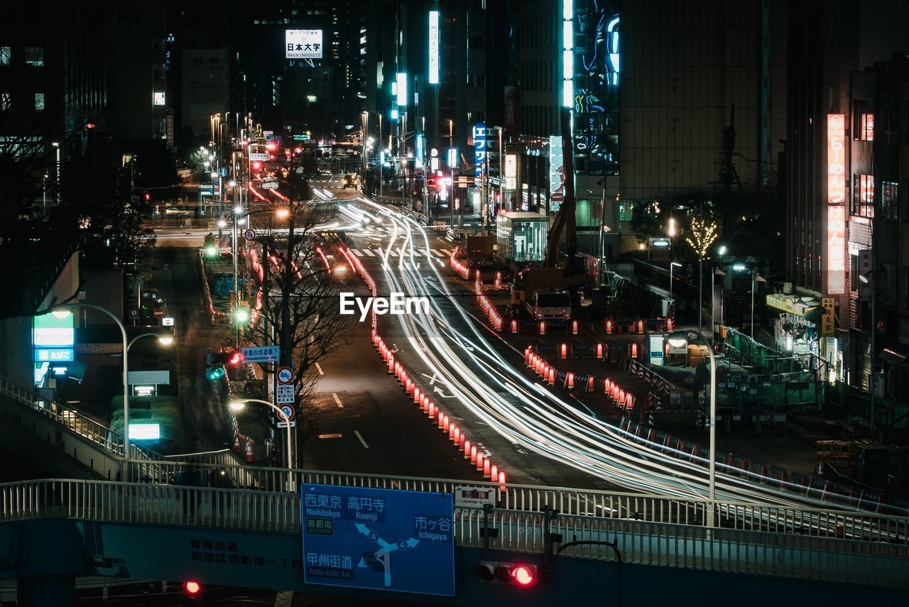 illuminated, night, architecture, built structure, city, transportation, building exterior, light trail, road, long exposure, street, motion, city life, traffic, connection, speed, high angle view, cityscape, bridge, no people, bridge - man made structure, outdoors, office building exterior, multiple lane highway, skyscraper