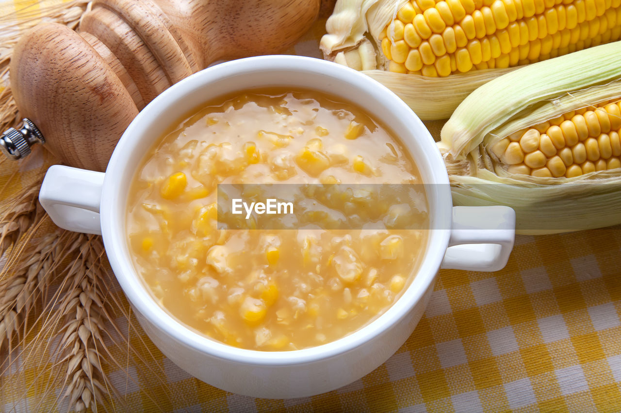 food and drink, food, freshness, bowl, healthy eating, wellbeing, corn, table, still life, vegetable, ready-to-eat, indoors, high angle view, close-up, sweetcorn, no people, serving size, spoon, kitchen utensil, temptation