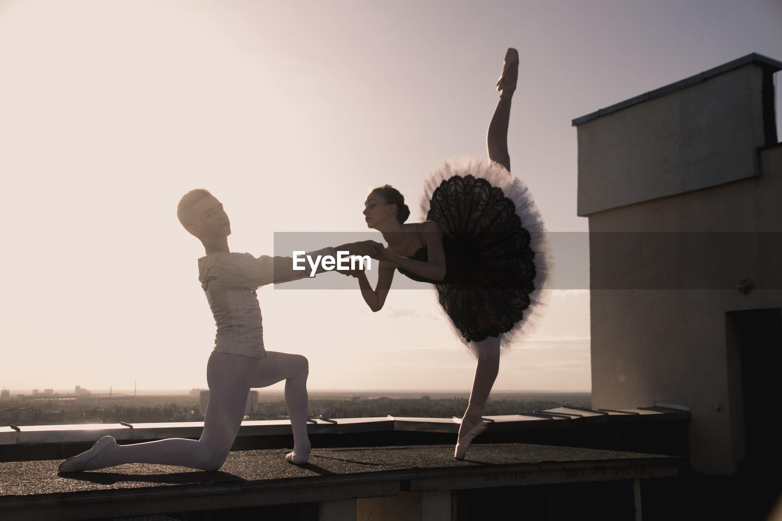 Full length of ballet dancers on roof
