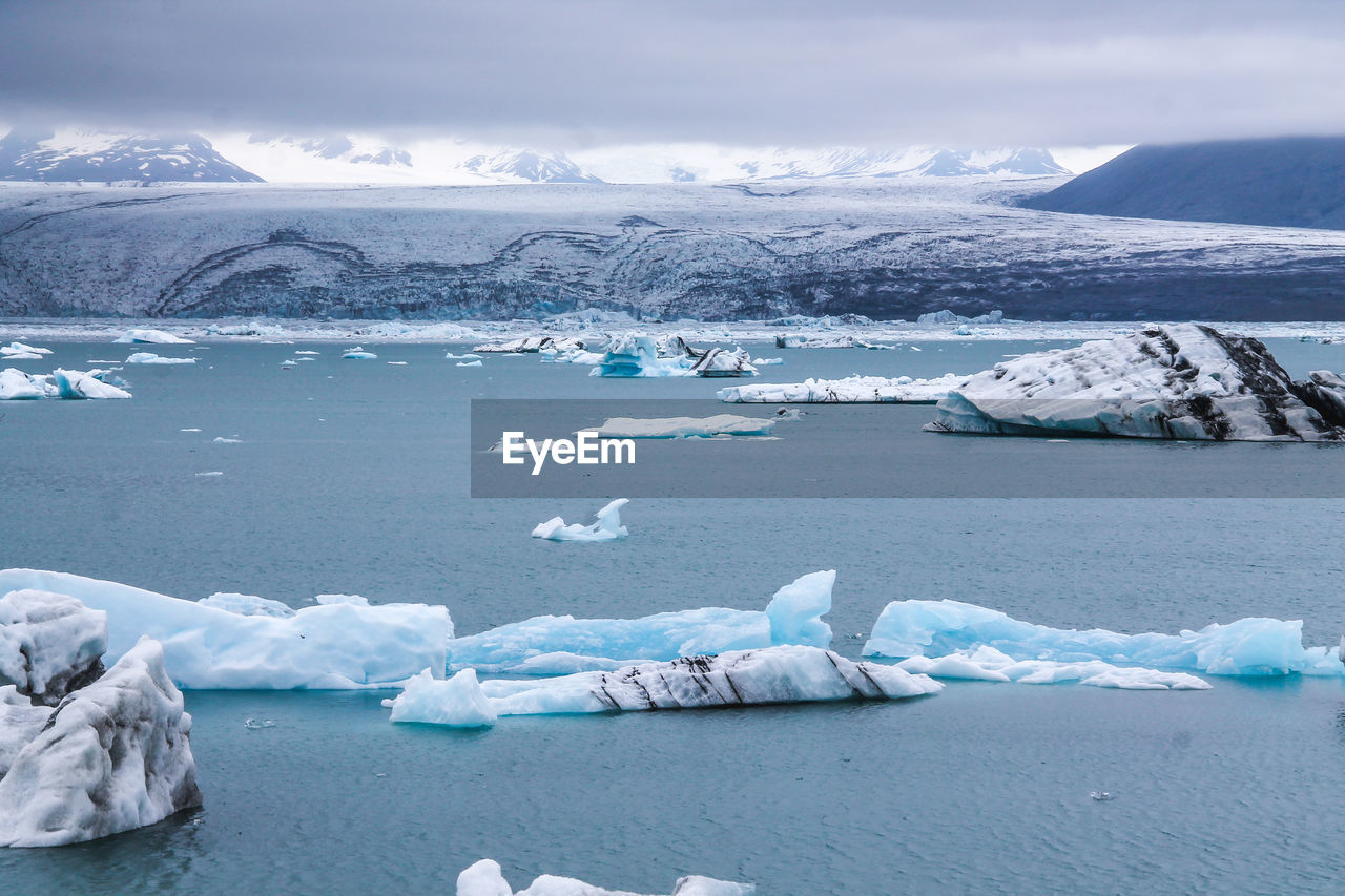 cold temperature, ice, winter, glacier, frozen, water, snow, scenics - nature, tranquil scene, environment, iceberg, tranquility, landscape, beauty in nature, sky, nature, day, no people, melting, floating on water, outdoors, snowcapped mountain