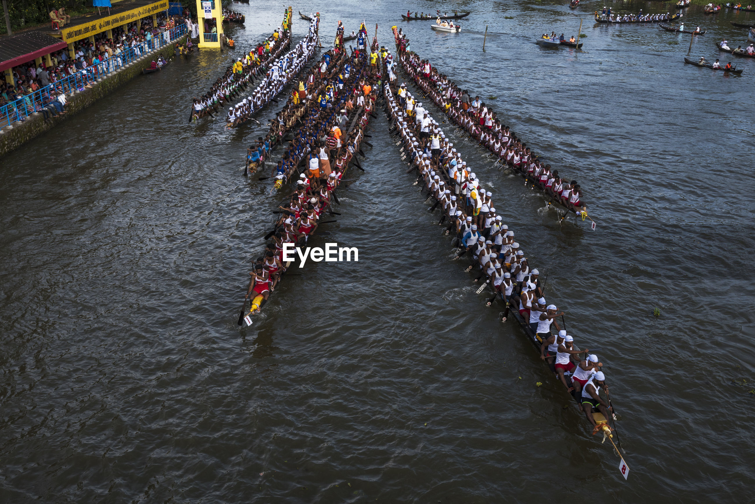 HIGH ANGLE VIEW OF PEOPLE ON RIVER