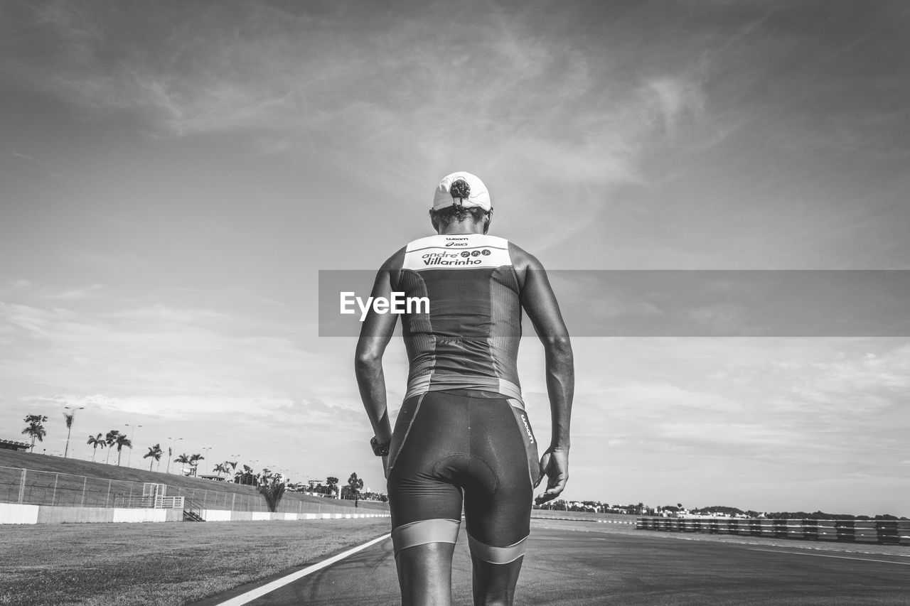 sky, cloud - sky, real people, rear view, one person, outdoors, men, standing, day, helmet, young adult, nature, adult, people