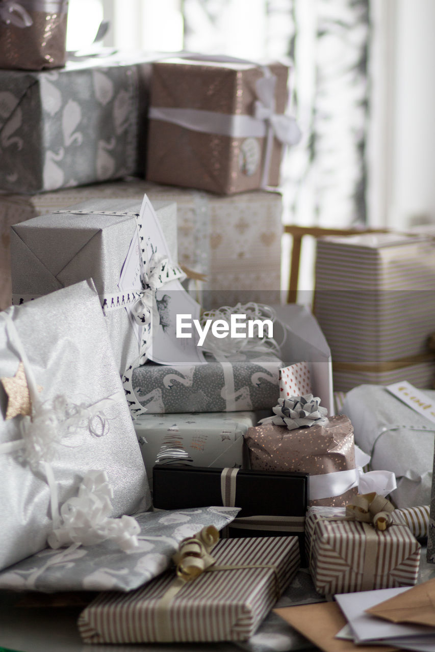 indoors, pillow, furniture, no people, still life, table, gift, domestic room, cushion, home interior, celebration, cake, wedding, container, selective focus, decoration, event, day, absence, box - container