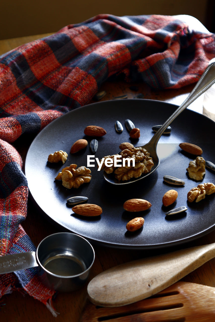 food and drink, food, freshness, plate, table, still life, indoors, healthy eating, wellbeing, ready-to-eat, no people, eating utensil, spoon, kitchen utensil, bowl, close-up, high angle view, nut, nut - food, serving size, breakfast