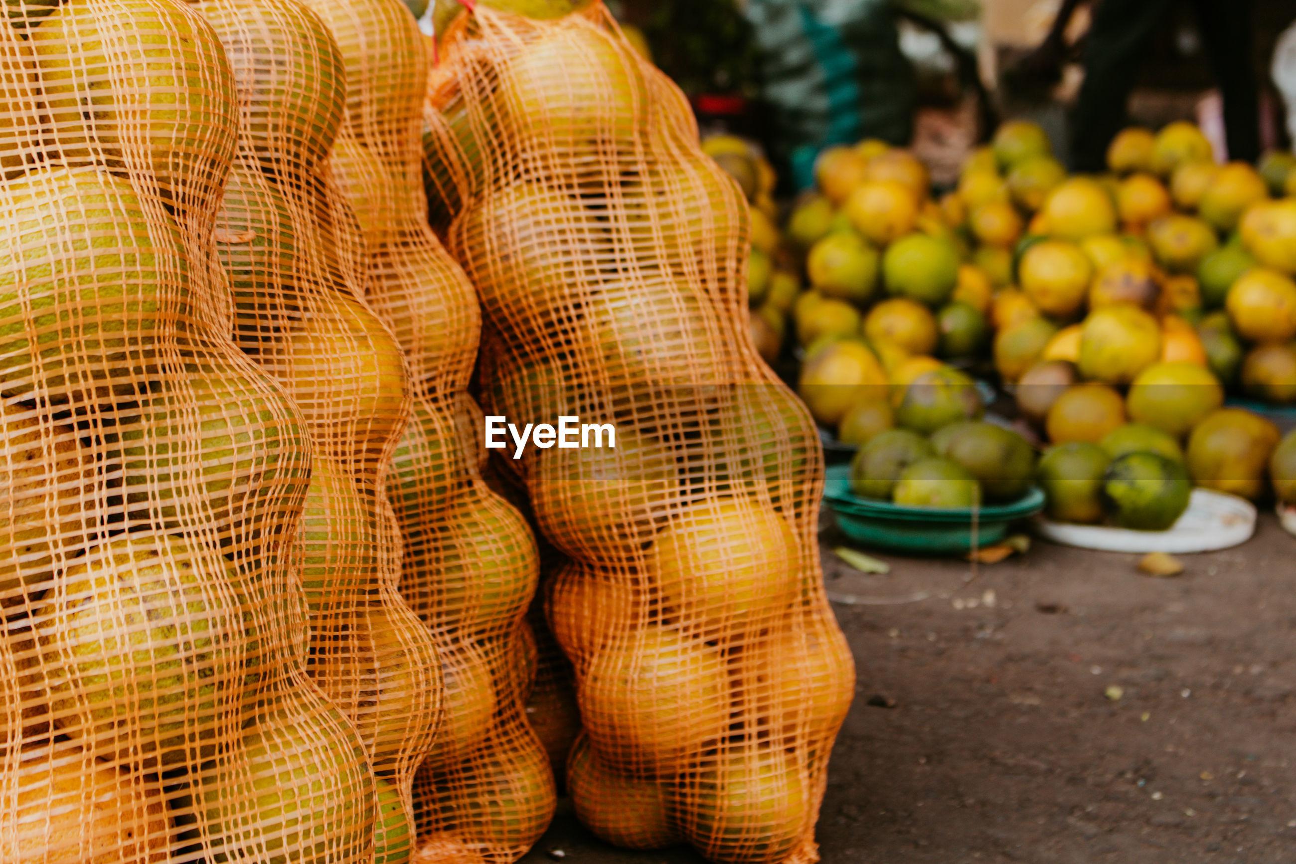 Orange fruits for sale at street market