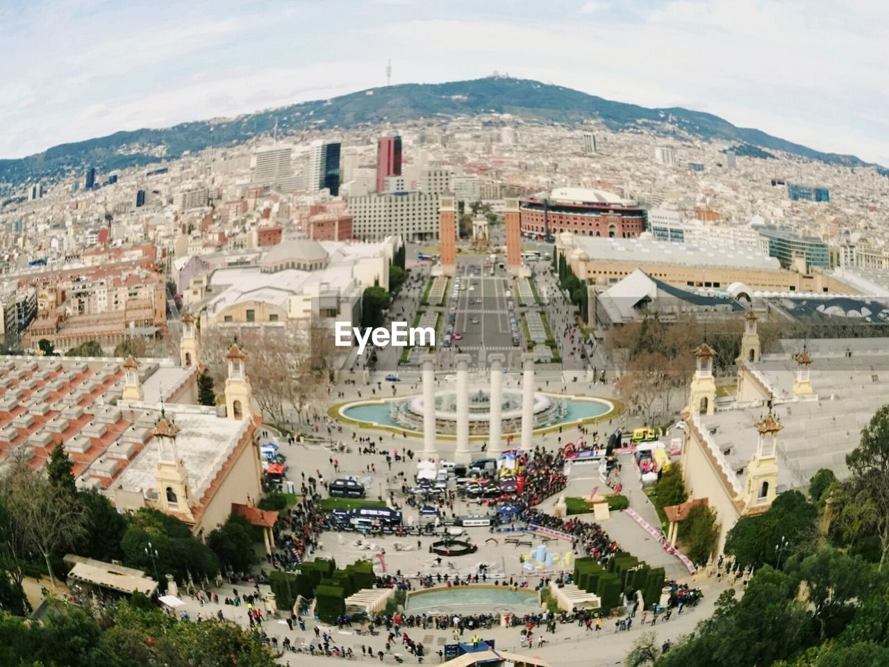architecture, built structure, building exterior, high angle view, history, day, outdoors, travel destinations, mountain, sky, tree, large group of people, nature, ancient civilization, city, people