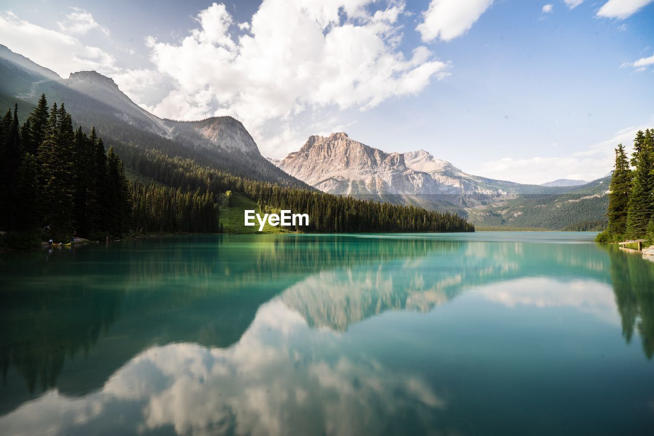 mountain, lake, scenics - nature, beauty in nature, reflection, cloud - sky, water, tranquil scene, sky, tranquility, mountain range, tree, idyllic, plant, nature, non-urban scene, waterfront, day, no people, snowcapped mountain, reflection lake, mountain peak, coniferous tree