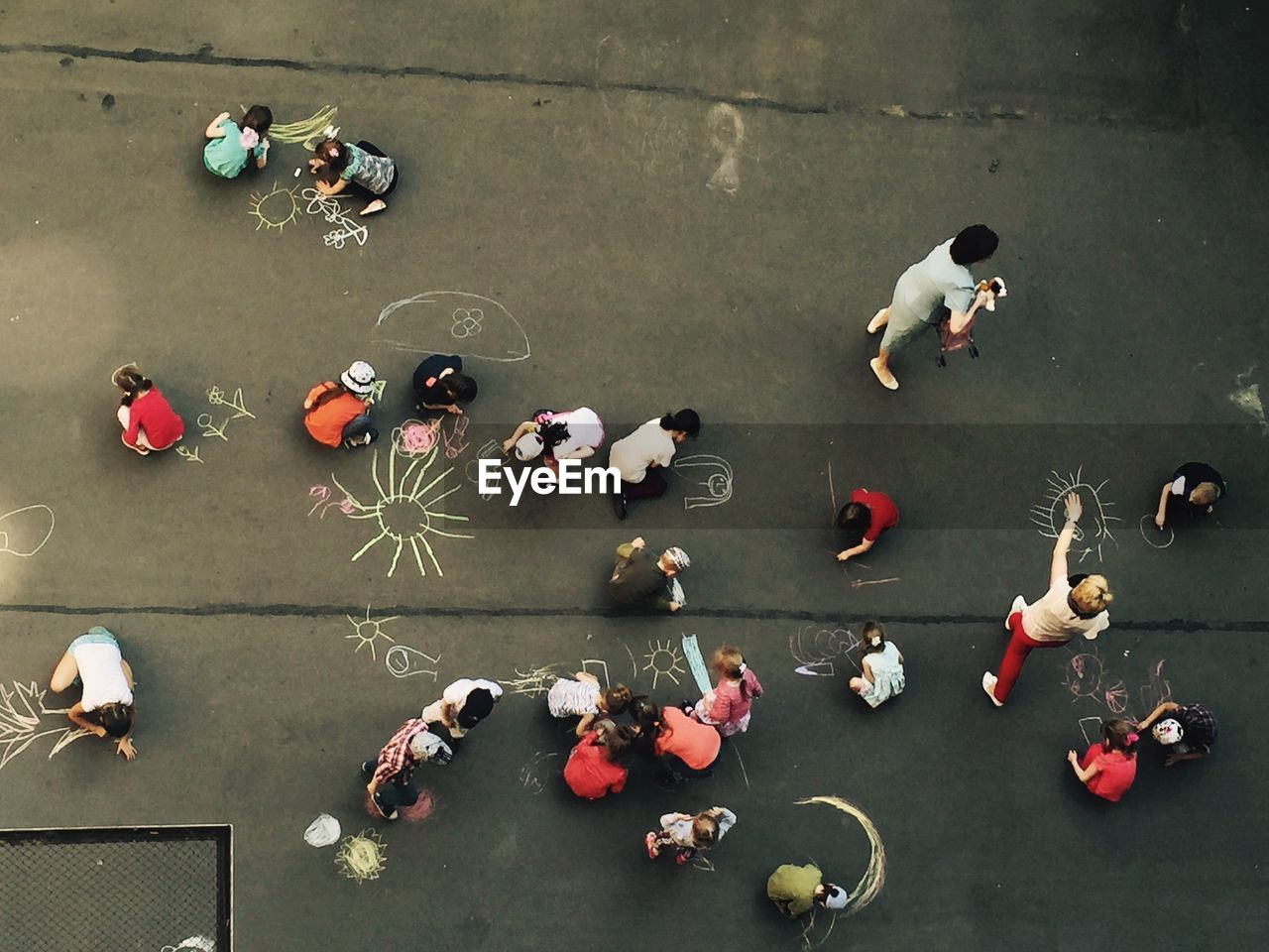 Directly Above Shot Of Children Drawing On Playground