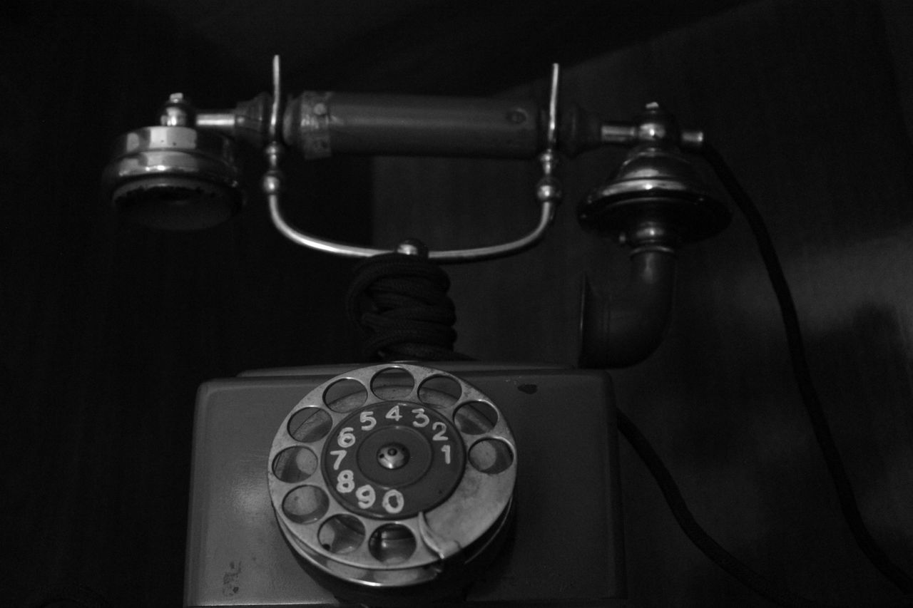 technology, indoors, communication, telephone, no people, connection, landline phone, retro styled, close-up, rotary phone, nostalgia, still life, focus on foreground, single object, antique, table, number, telephone receiver, the past, aggression