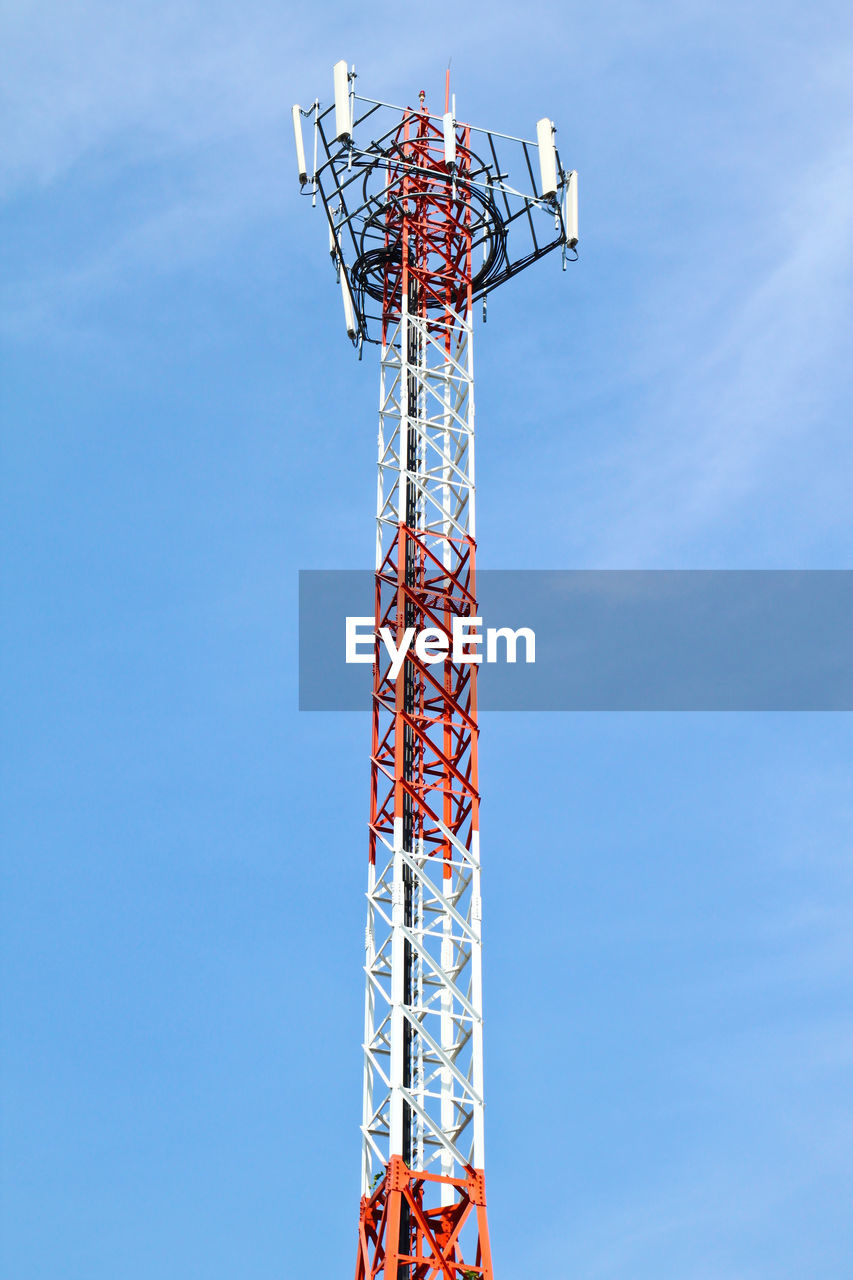 sky, low angle view, blue, nature, day, architecture, amusement park, built structure, amusement park ride, outdoors, metal, no people, cloud - sky, tall - high, arts culture and entertainment, tower, communication, technology, red, copy space, global communications