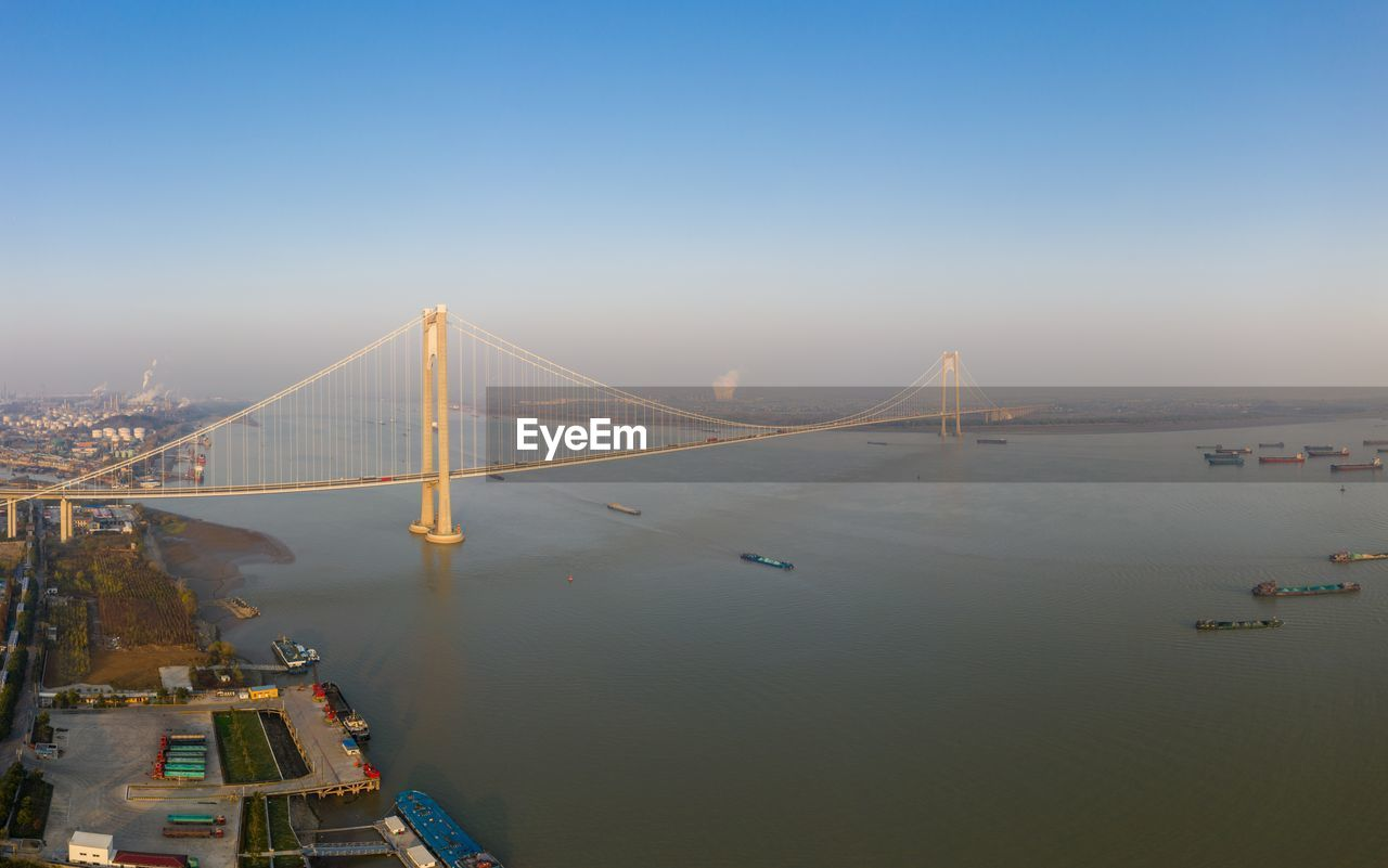 VIEW OF SUSPENSION BRIDGE OVER BAY