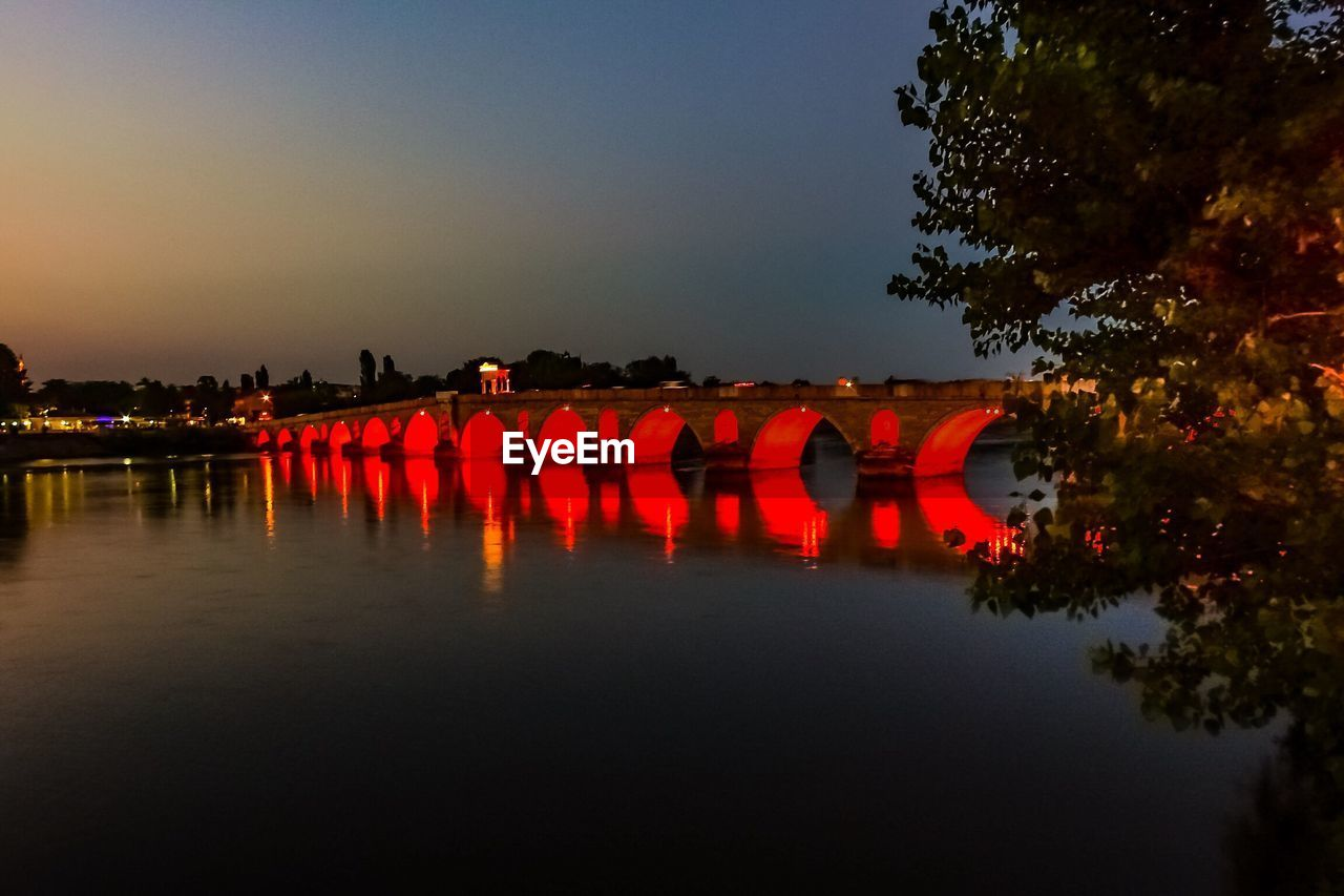 water, sky, reflection, nature, waterfront, bridge, river, red, tree, connection, illuminated, orange color, bridge - man made structure, no people, built structure, architecture, sunset, plant, arch bridge