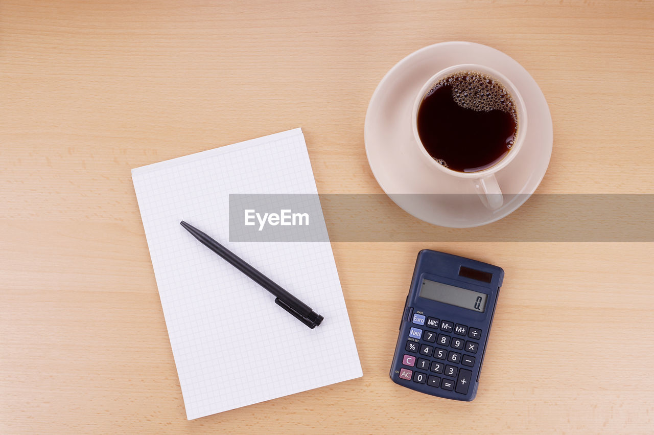 pen, table, coffee cup, still life, indoors, coffee - drink, drink, no people, desk, high angle view, directly above, pencil, refreshment, food and drink, paper, note pad, diary, technology, close-up, freshness, day