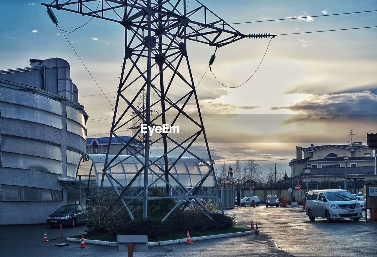 architecture, built structure, sky, building exterior, car, transportation, cloud - sky, land vehicle, cable, mode of transport, city, no people, outdoors, sunset, day, electricity pylon