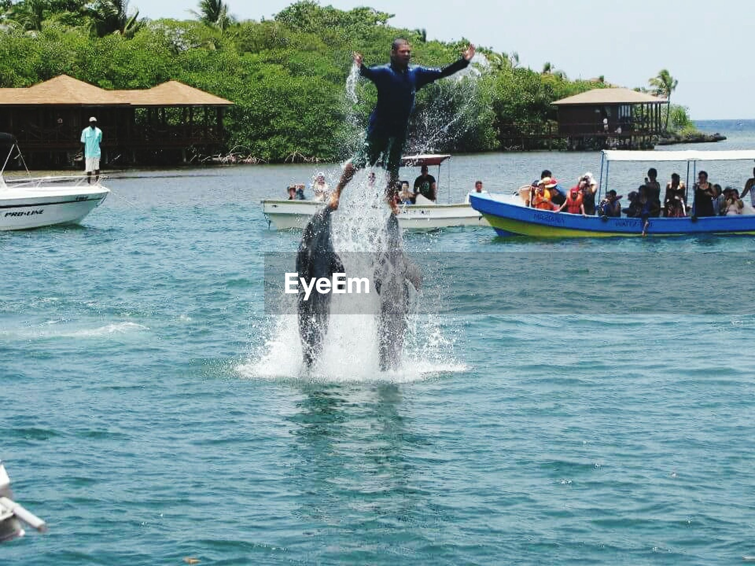 water, lifestyles, leisure activity, men, waterfront, sea, person, vacations, large group of people, nautical vessel, tourist, enjoyment, medium group of people, transportation, travel, tourism, motion, mode of transport, rippled