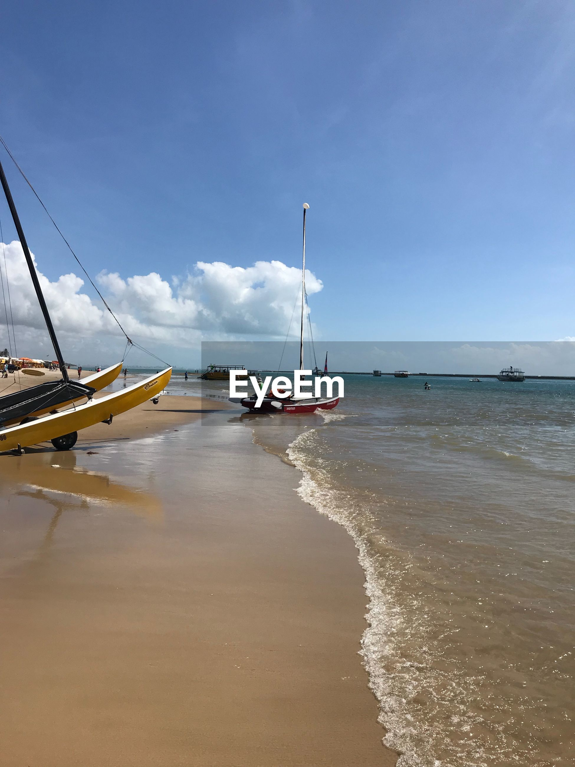 water, sea, sky, transportation, nautical vessel, mode of transportation, beach, land, beauty in nature, day, cloud - sky, nature, scenics - nature, moored, tranquil scene, no people, sand, travel, tranquility, horizon over water, outdoors, sailboat, anchored