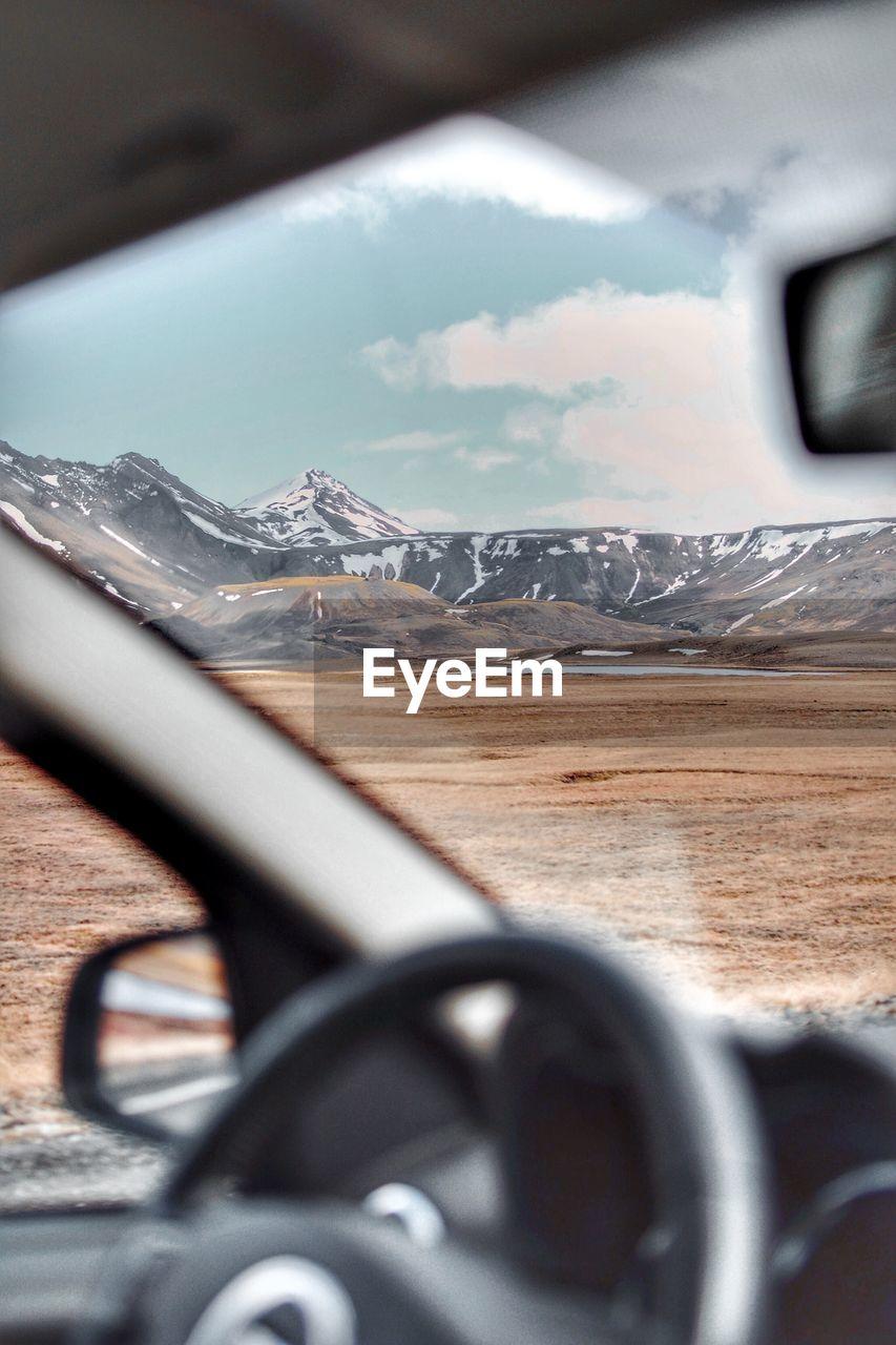 Mountains seen through car