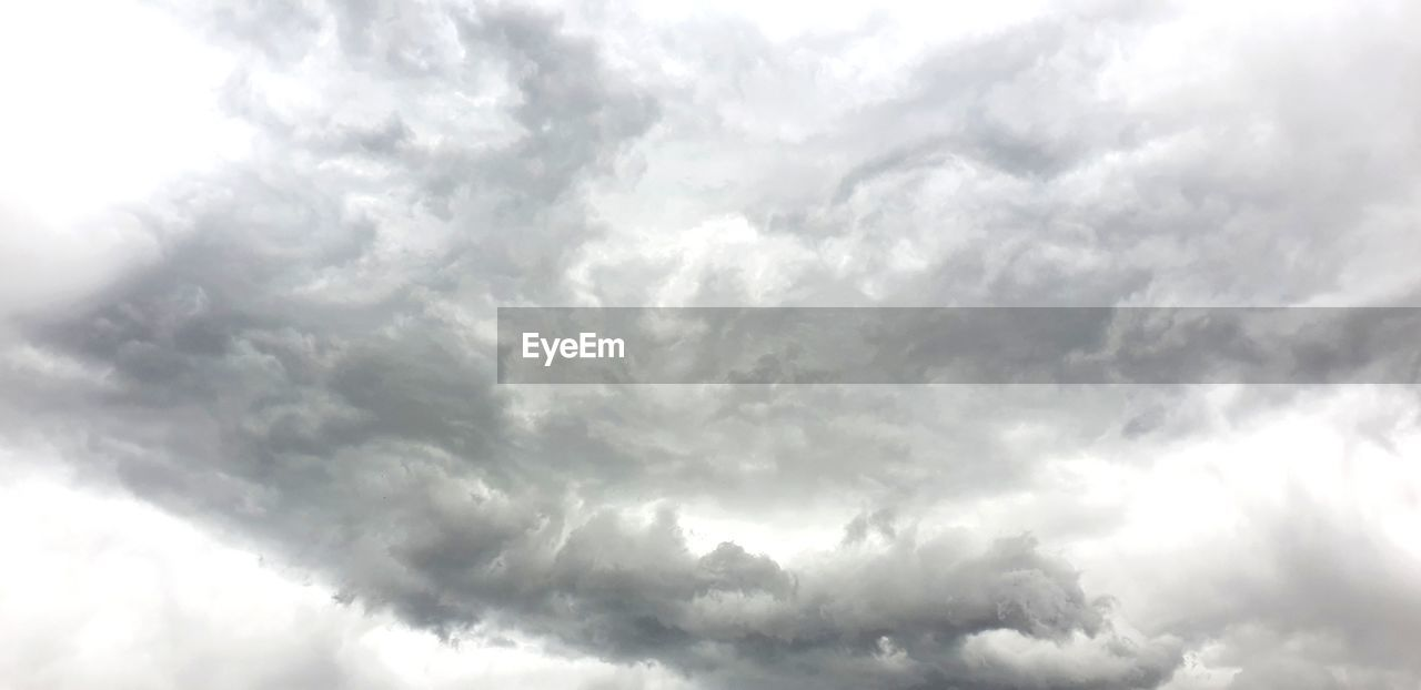 cloud - sky, sky, beauty in nature, low angle view, scenics - nature, no people, storm, day, nature, tranquility, cloudscape, outdoors, storm cloud, backgrounds, overcast, dramatic sky, full frame, tranquil scene, white color, meteorology