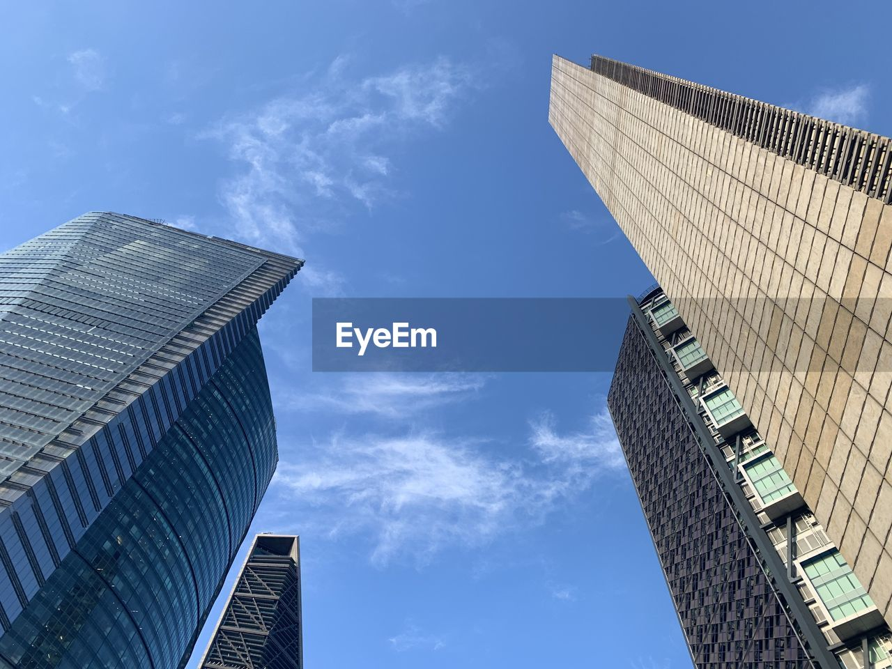 architecture, built structure, building exterior, sky, low angle view, building, city, cloud - sky, office building exterior, nature, modern, day, tall - high, office, blue, skyscraper, no people, tower, outdoors, financial district
