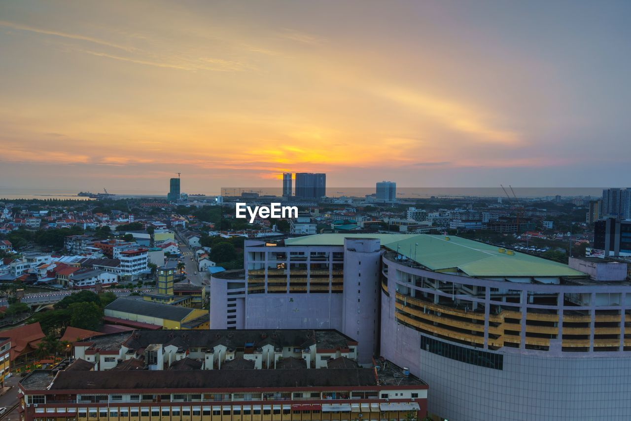 architecture, building exterior, built structure, cityscape, sunset, city, sky, high angle view, no people, skyscraper, outdoors, nature, day