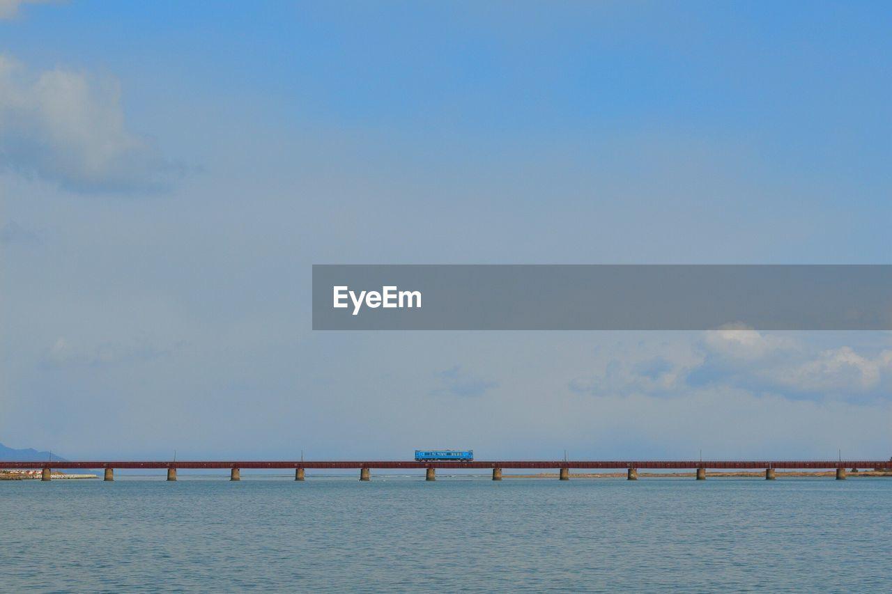 View Of Railroad Car On Railway Bridge Across River