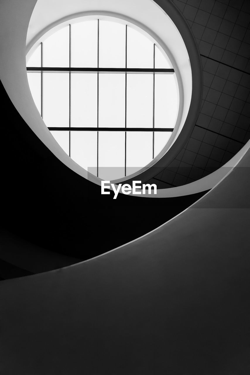 built structure, architecture, indoors, no people, geometric shape, shape, skylight, low angle view, pattern, day, circle, ceiling, staircase, steps and staircases, design, railing, glass - material, window, wall - building feature, architectural feature, modern, directly below, semi-circle