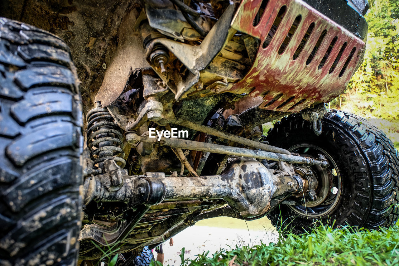 wheel, tire, transportation, land vehicle, day, mode of transport, car, no people, outdoors, off-road vehicle, water, grass, close-up