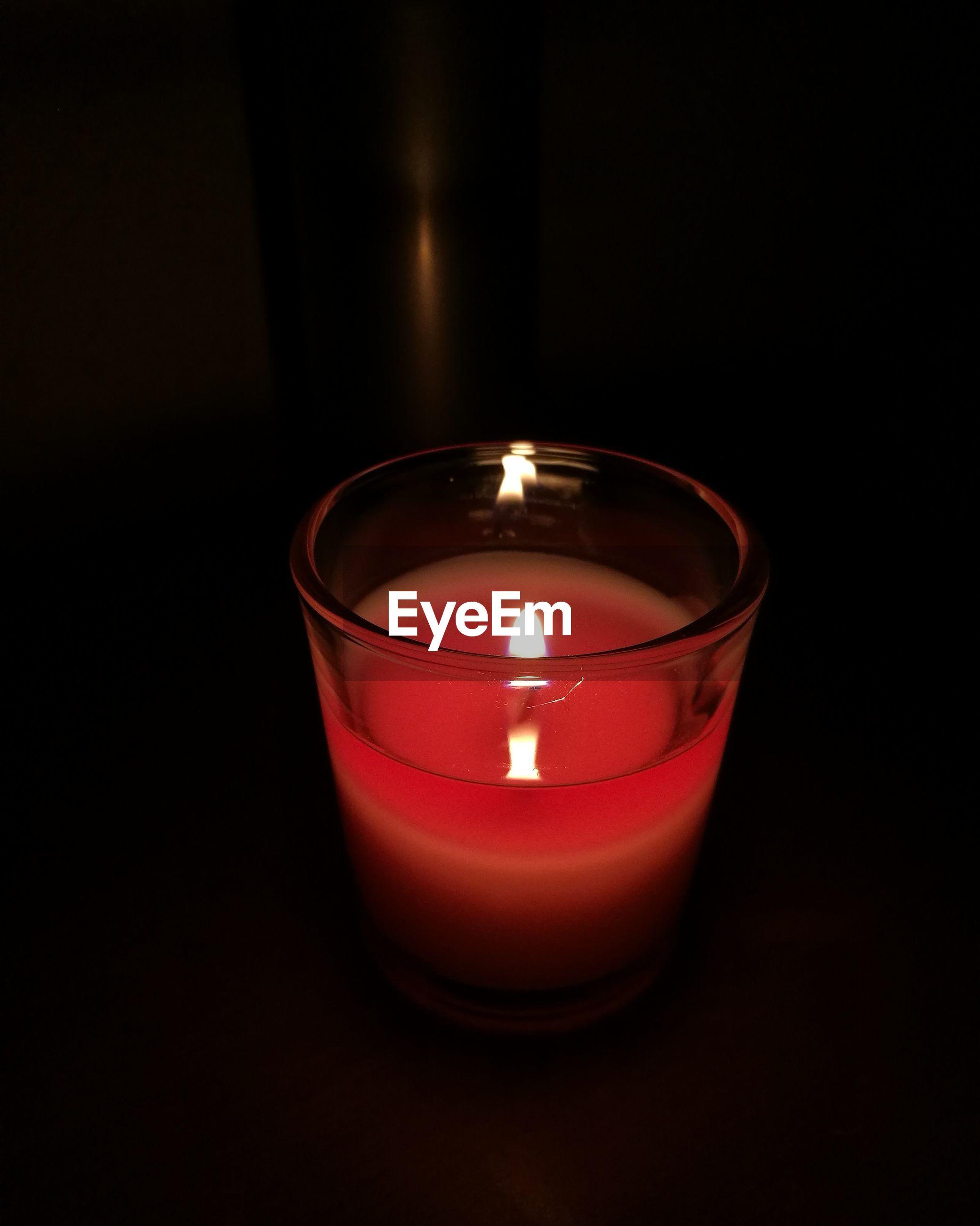 candle, flame, burning, heat - temperature, illuminated, darkroom, tea light, glowing, no people, lighting equipment, indoors, close-up, night, black background, diya - oil lamp