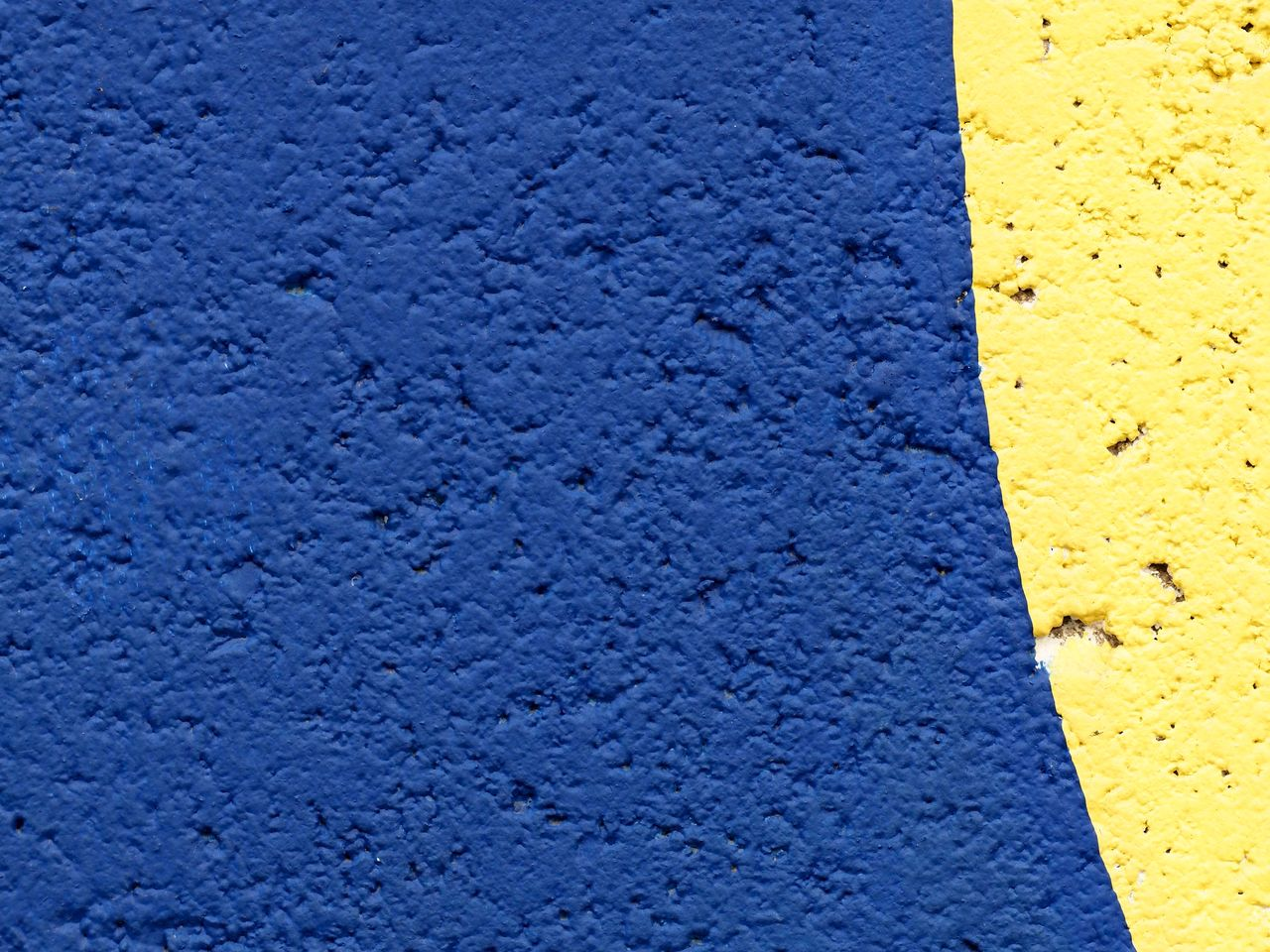blue, yellow, textured, backgrounds, no people, full frame, close-up, built structure, architecture, wall - building feature, day, pattern, rough, outdoors, building exterior, high angle view, concrete, gray, copy space, street