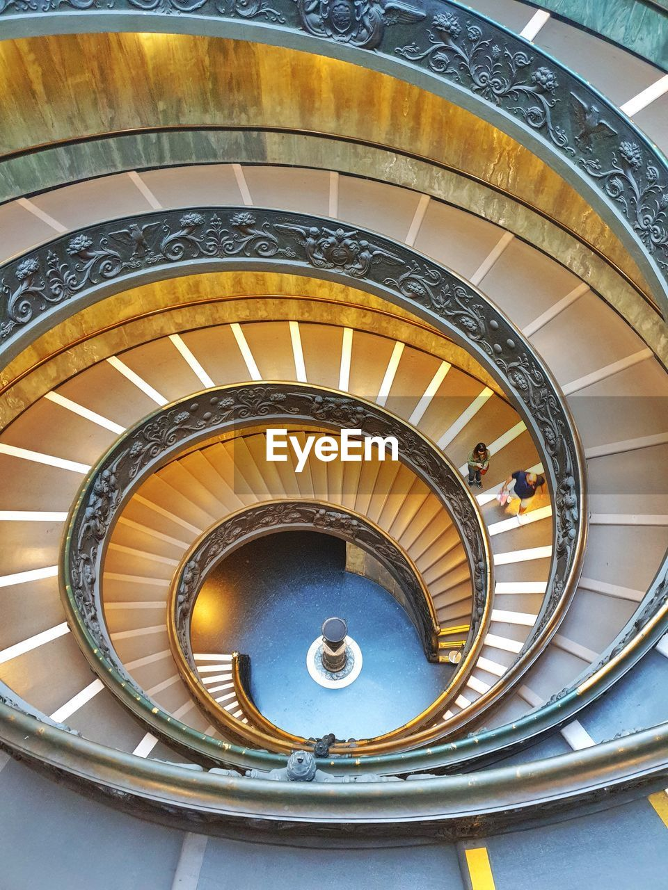 architecture, spiral, railing, staircase, steps and staircases, spiral staircase, built structure, indoors, pattern, design, high angle view, day, curve, architectural feature, directly above, no people, shape, travel, ceiling