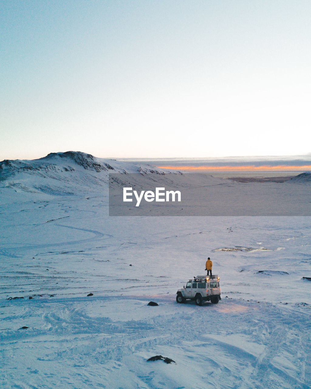 Scenic View Of Landscape Against Clear Sky During Winter