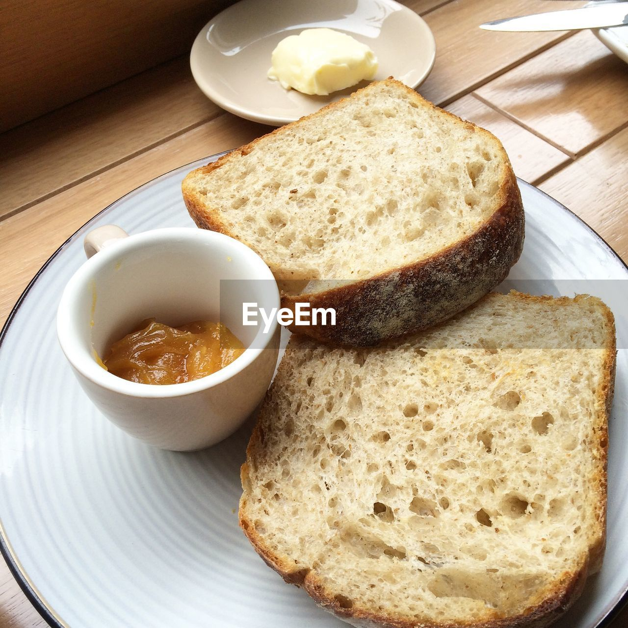 Close-Up Of Served Bread Slices In Plate