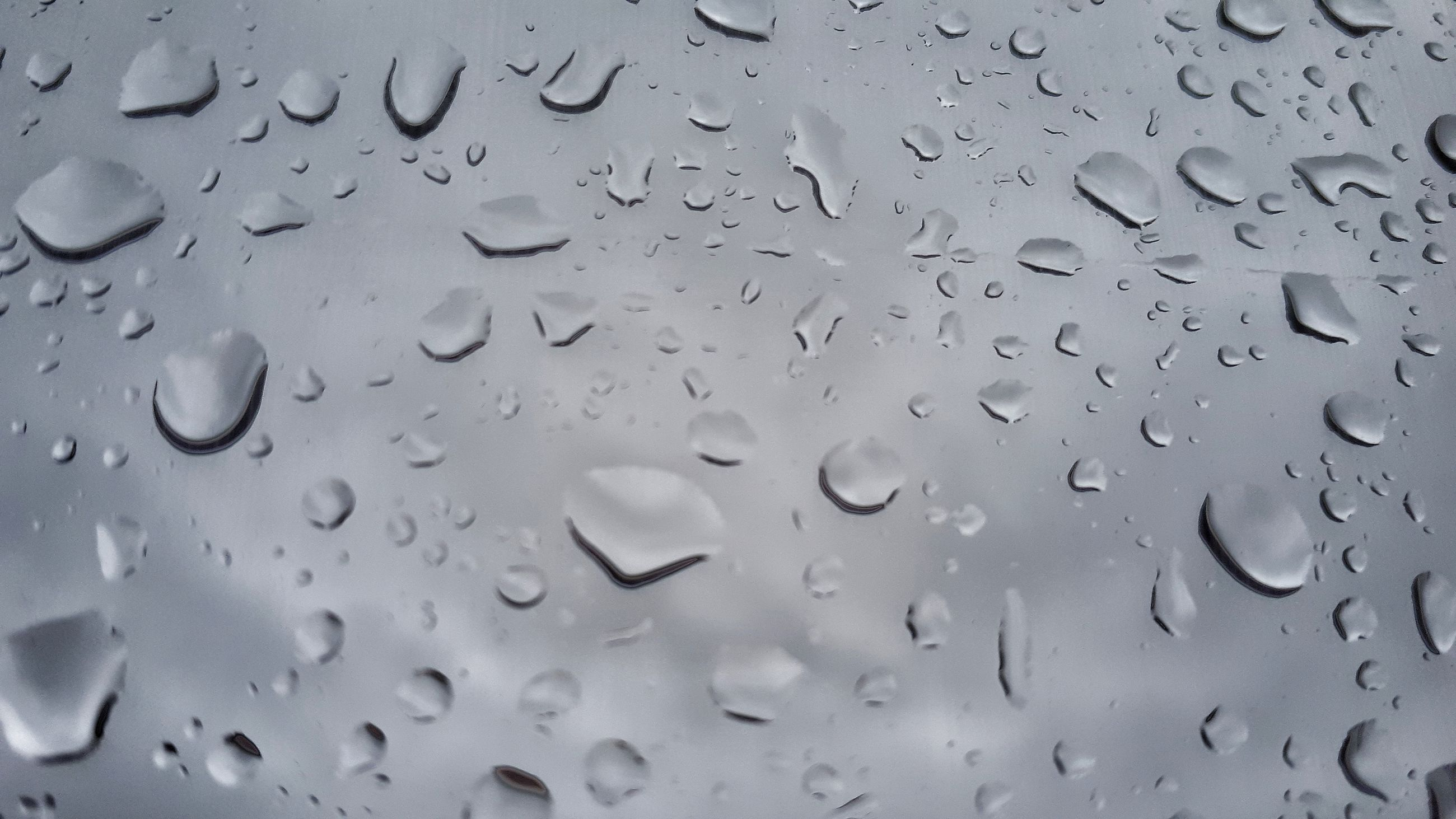 drop, wet, water, full frame, rain, glass - material, no people, transparent, close-up, backgrounds, window, indoors, raindrop, rainy season, nature, focus on foreground, day