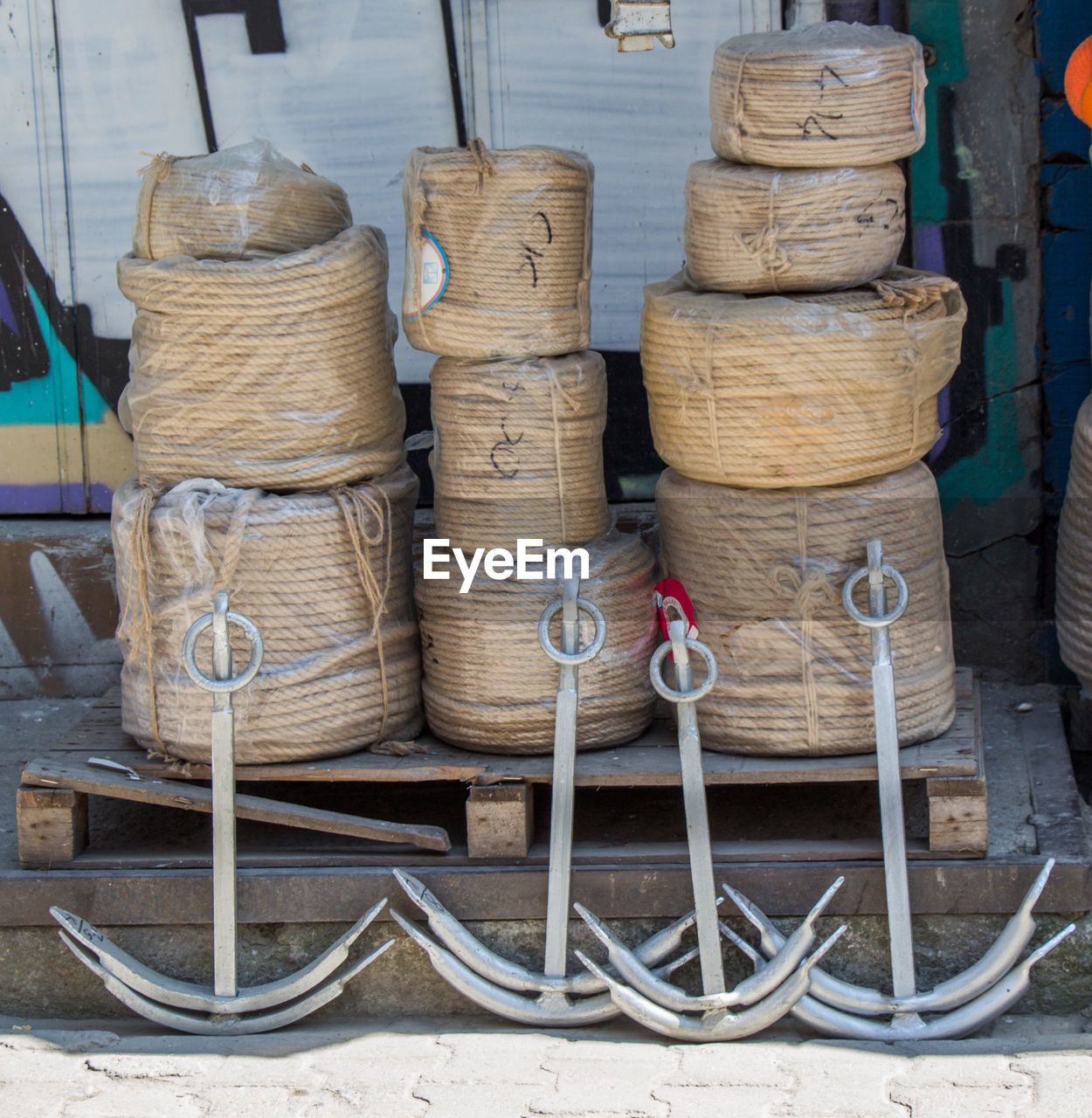 stack, large group of objects, wood - material, no people, day, abundance, container, industry, still life, factory, indoors, spool, warehouse, metal, focus on foreground, thread, barrel, arrangement, basket