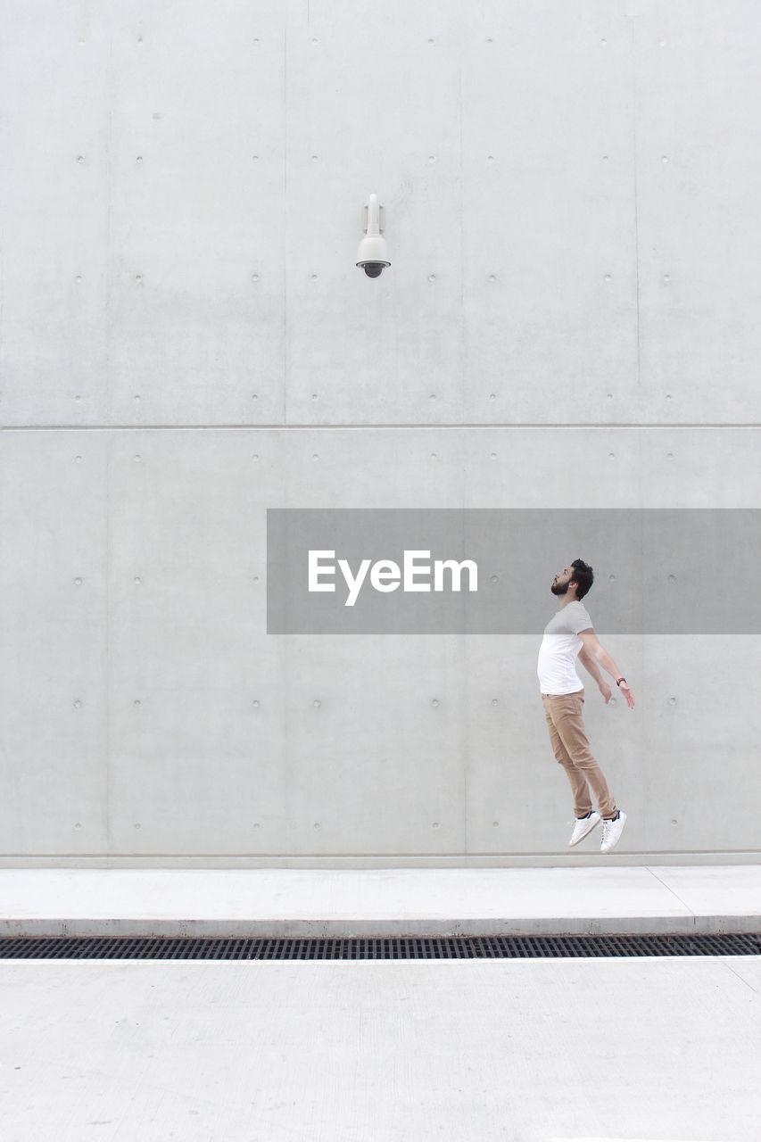 Full Length Of Man Jumping On Street