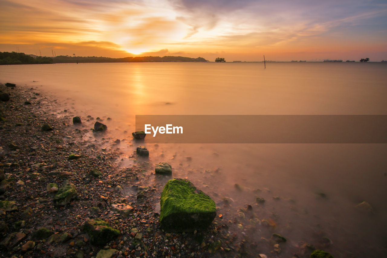 sunset, sky, water, scenics - nature, beauty in nature, cloud - sky, tranquility, tranquil scene, sea, orange color, nature, no people, idyllic, rock, solid, beach, land, rock - object, non-urban scene, outdoors