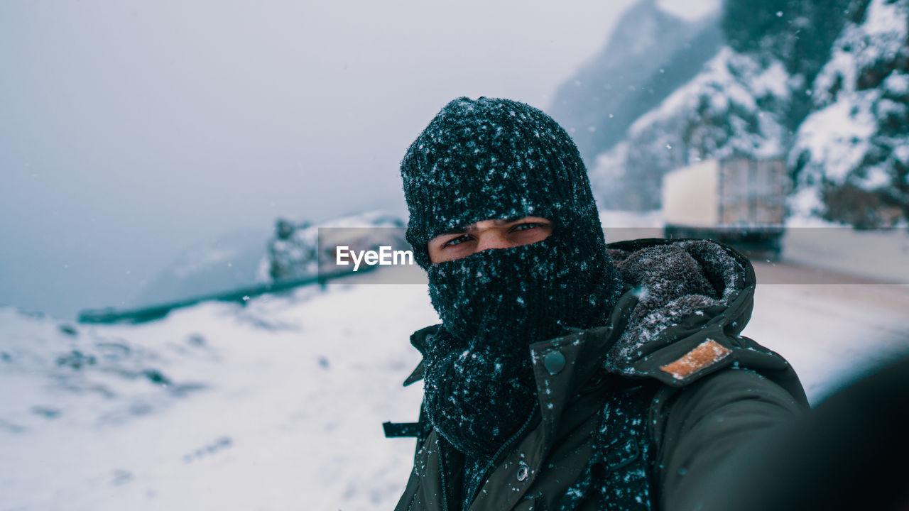 Portrait of man wearing hat during winter