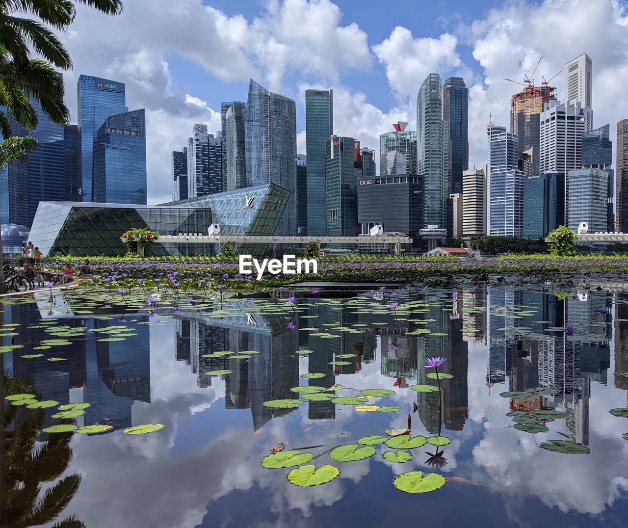 REFLECTION OF BUILDINGS ON LAKE IN CITY