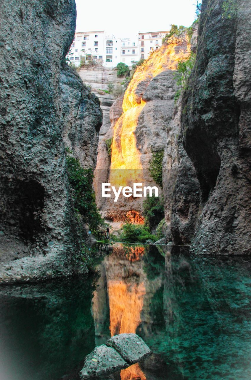 rock formation, rock - object, nature, no people, built structure, day, beauty in nature, outdoors, motion, scenics, tree, architecture, water, mountain, waterfall, sky