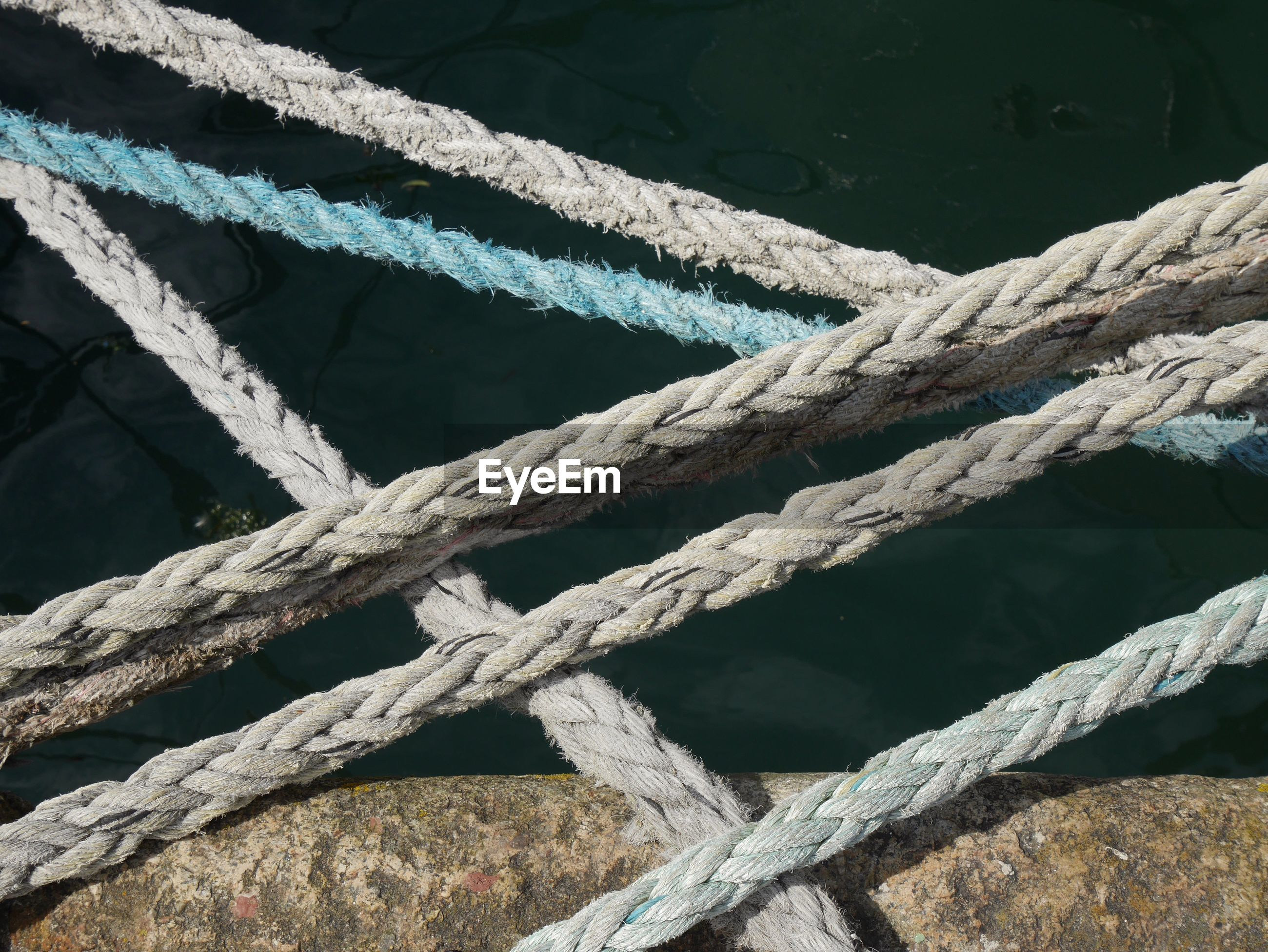 Close-up of rope over sea